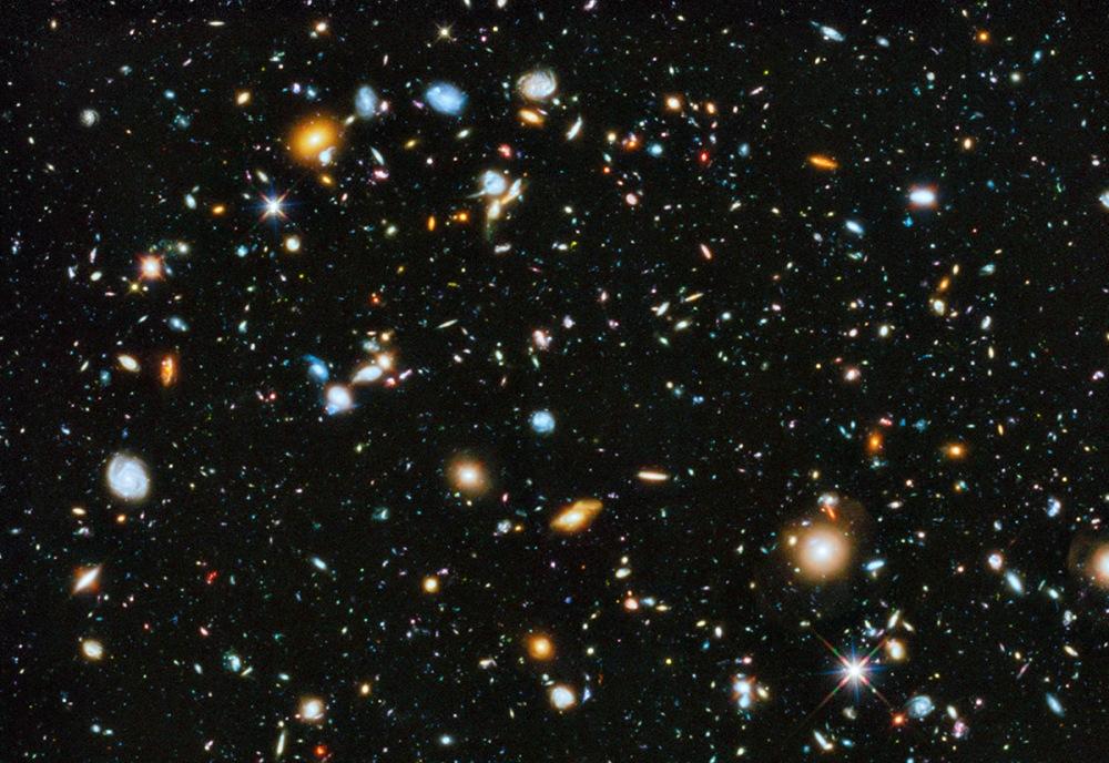 تصویر، فرا ژرف هابل ورژن 2014 نمونه ای از قدیمیترین کهکشانهایی است که بشر تاکنون دیده است؛ کهکشانهایی که کمی پس از دوران تاریک وجود داشتند، زمانی که تنها چند صد میلیون سال از بیگ بنگ گذشته بود. اعتبار: NASA, ESA