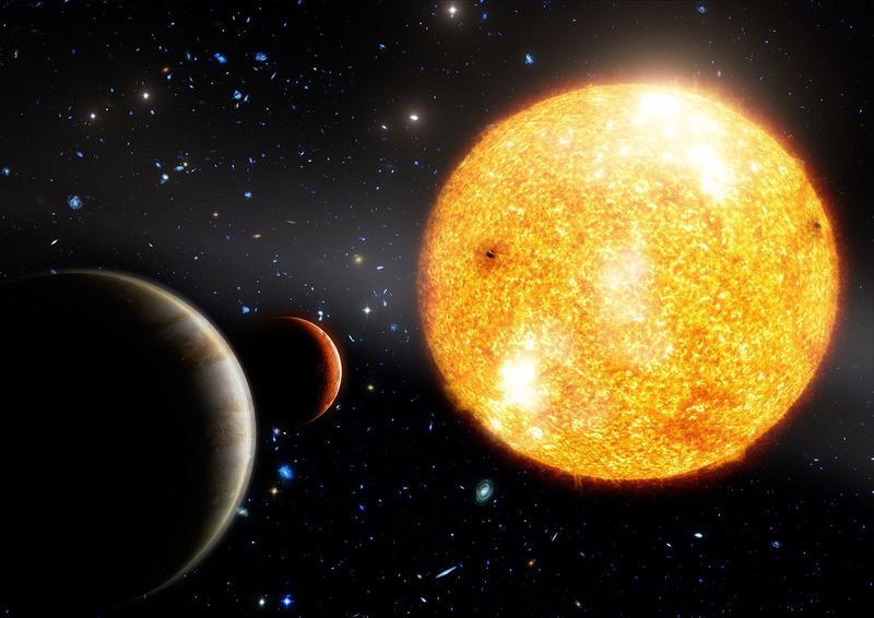 تصویری هنری از منظومۀ ستاره ای 11952 HIP و دو سیاره مشتری مانند آن