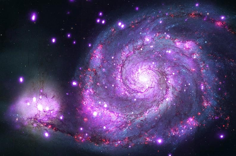 تصویری از کهکشان M51 در نور پرتو ایکس که توسط تلسکوپ فضایی چاندرا ناسا ثبت شده است.