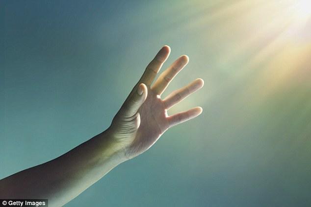 1412641274565_wps_53_A_hand_reaching_towards_g