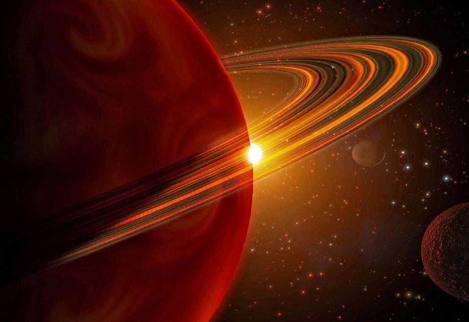 تصویری هنری از یک سیاره ی گازی غول پیکر و قمرهایش