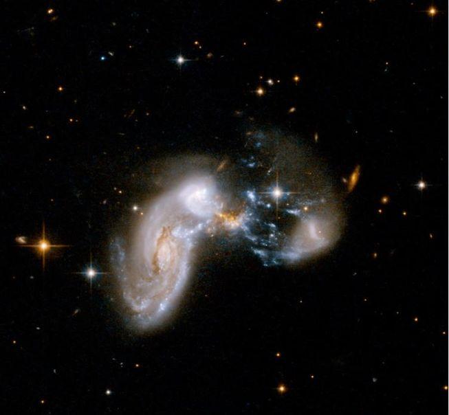 """فعال ترین کهکشان ستاره ساز در جهان دور با نام کهکشان""""Baby Boom""""، طبق گفته ناسابسیار شبیه به کهکشانی است که در اینجا نشان داده شده که Zw II 96 نام دارد. این کهکشان در سال حدود 4000 ستاره ی جدید تولید می کند."""