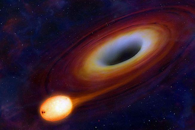 تصویر هنری از لحظه ی بلعیدن یک ستاره توسط سیاهچاله