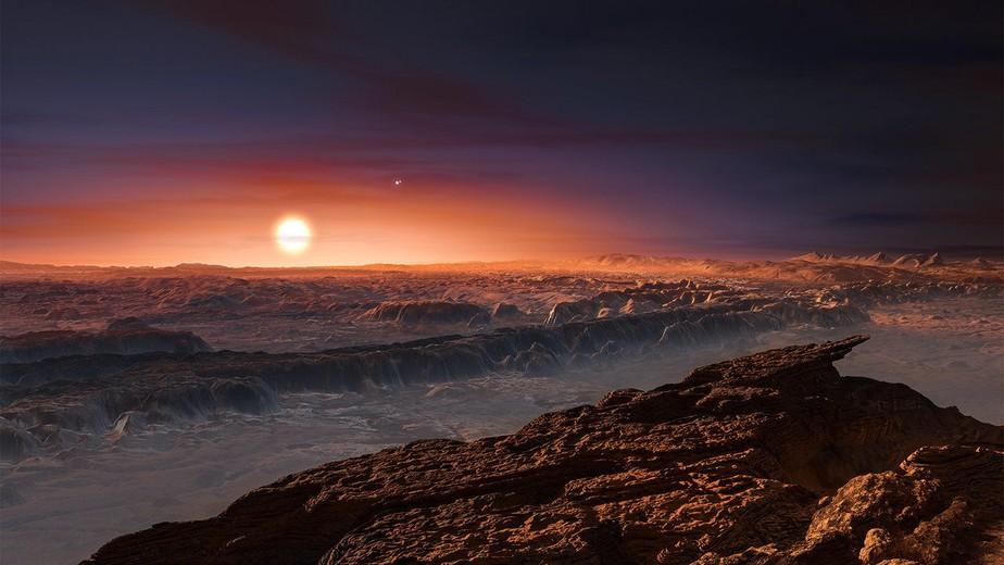 این تصویر هنری نمایی از سطح سیاره پروکسیما b را در حال گردش به دور ستاره کوتوله قرمز پروکسیما قنطورس نشان می دهد که نزدیکترین ستاره به منظومه شمسی است.